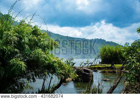 Lake Landscape Photography In The Rainforest During The Day Time Athirapally Waterfalls, Kerala, Ind