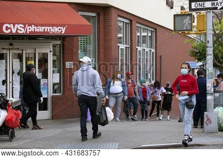 Bronx, New York/usa - May 18, 2020: People Standing On Line Waiting To Be Tested For Covid-19 At A C