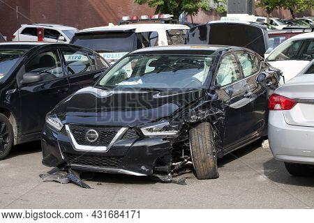Bronx, New York/usa - May 18, 2020: A Damaged Vehicle Parked And Abandoned.