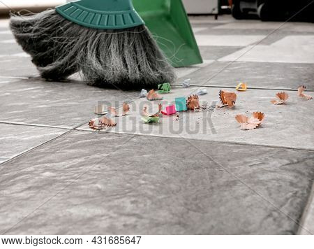 Sweep Up Scraps Of Paper And Dust On Tile Floors With A Broom And A Plastic Dustpan.
