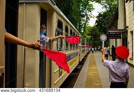 Kyiv, Ukraine-august 22, 2021:detailed View. Train Dispatch Is Delayed. Сonductors Hold Red Flags. T