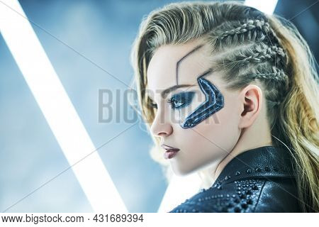 Sideview portrait of a beautiful sci-fi cyborg girl among the neon lights. Cyberpunk concept. Make-up and hairstyle.