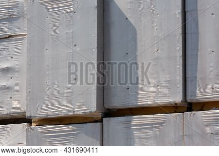 Stacked Boxes With Goods Xovered With White Shrink Film - Close-up View On Outdoor Storage