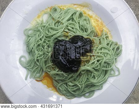 Spice Green Noodles In White Plate With Black Sauce