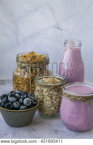 Blueberry Smoothie Topped With Blueberries. A Glass Of Breakfast Protein Smoothie Drink Made From Pu