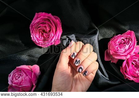 Amor Word On Nails Manicure Hold Pink Rose Flower On Black Silk Fabric. Love, Minimal Flat Lay Natur