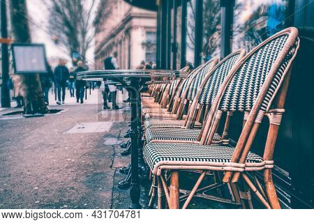 Small street cafe terrace in Paris