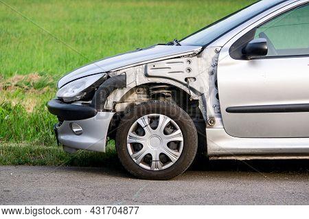 Ostrava, Czech Republic - July 12, 2021: A Detail Of A Frontal Part Of Silver Peugeot 206 Car Damage