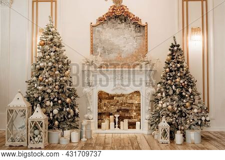 Two Decorated Christmas Trees On The Sides Of The Hall And A Fireplace In The Center. Christmas And