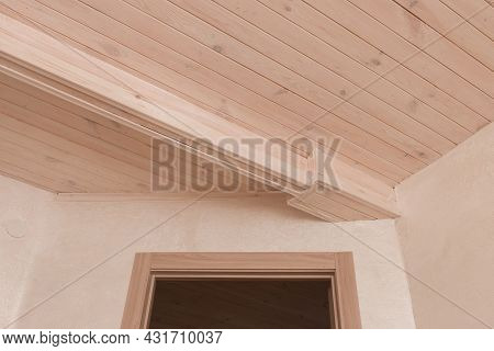 Doorway In The Modern Interior Of The Room With Wooden Ceiling.
