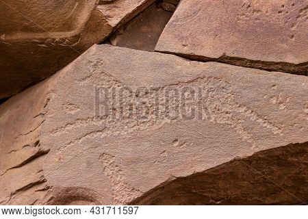 Ancient Petroglyphs On Rock In Sunduki Mountain Range At Republic Of Khakassia, Russia. Symbolic Eng