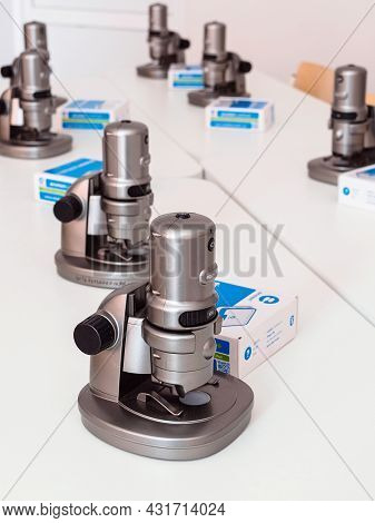 Moscow, Russia - August 30, 2021: Digital Microscopes Digital Blue Qx7 On The Tables In The Classroo