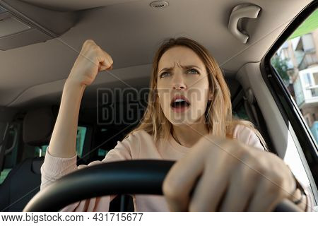 Stressed Angry Woman In Driver's Seat Of Modern Car