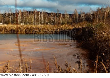 The Pipe Discharges Waste Into The Water. Contamination Of The Reservoir With Dangerous Toxic Substa
