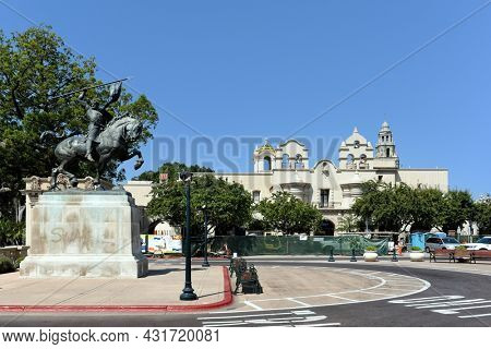 SAN DIEGO, CALIFORNIA - 25 AUG 2021: El Cid Statue in Balboa Park, with the Mingei International Museum in the background.
