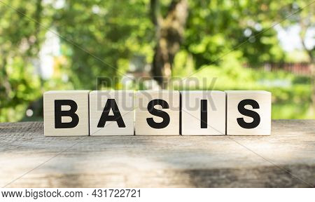 Five Wooden Blocks Lie On A Wooden Table Against The Backdrop Of A Summer Garden And Create The Word