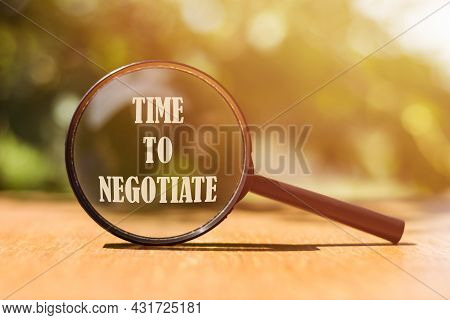 The Word Time To Negotiate On Magnifier In Sunlight.