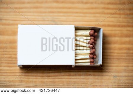 Cardboard Box With Matchsticks On A Wooden Background, Blank Space Top View. Space For Design,flat L
