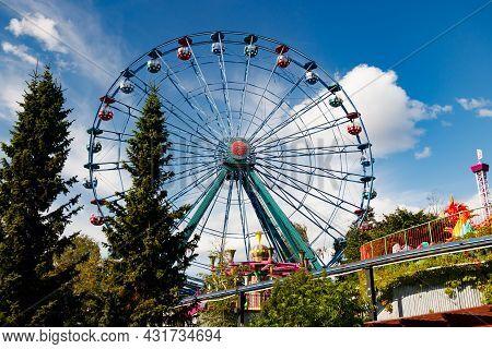 Helsinki, Finland - 23 July 2021: Linnanmaki Amusement Park, Colorful Ferris Wheel Rinkeli In Amusem