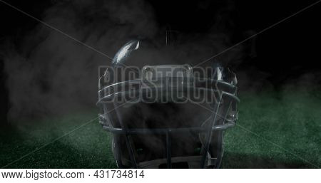 Image of close up of an American football player in a helmet on a field with clouds of smoke 4k