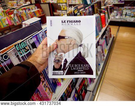 Paris, France - Feb 23, 2019: Man Holding Le Figaro Fashion Magazine With Headline Thank You Karl La