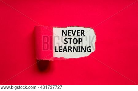 Never Stop Learning Symbol. Words 'never Stop Learning' Appearing Behind Torn Purple Paper. Beautifu