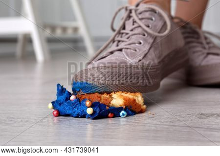 Woman Stepping On Dropped Cupcake Indoors, Closeup. Troubles Happen