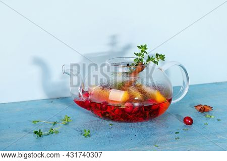 Immunity Boosting Drink. Winter Tea With Cranberries, Orange, Hibiscus And In Glass Teapot