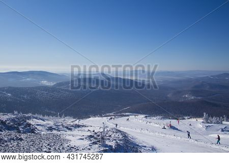 The Ski Slopes Of The Resort. Skiers And Snowboarders On The Slope Of The Ski Resort