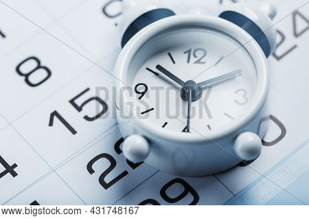 Annual Calendar With A White Alarm Clock On A Blue Background