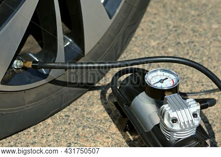 The Deflated Wheel Is Inflated By A Compressor Pump