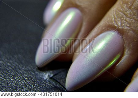 Selective Focus And Close-up Of Nails With A Manicure With Mother-of-pearl Varnish