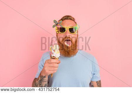 Hungry Man With Beard And Tattoos Eats A Big Icecream