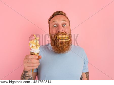 Hungry Man With Beard And Tattoos Is Undecided If To Eat An Icecream Or A Sandwich With Hamburger