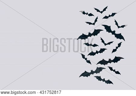 Halloween Background - Decorative Black Paper Bats On Light Gray Background With Copy Space For Text