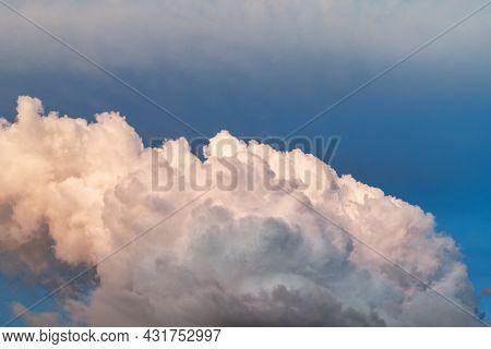 Big Fluffy White Cloud In A Blue Sky. Nature Cloudscape .