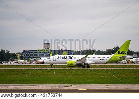 Riga, Latvia - August 31, 2021: Airbaltic Airbus A220-300 Yl-aas Landing/arrival In Riga/rix/evra Ai