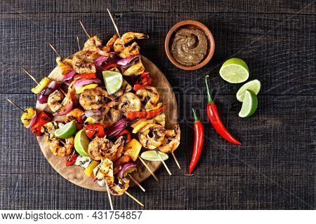 Grilled Shrimp Kabobs With Charred Red Onion, Sweet Pepper And Pineapple On A Wooden Cutting Board,