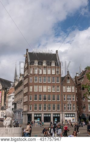 Amsterdam, Netherlands - August 14, 2021: Brown Stone With Dark Roof Corner Building Of Abn-amro Ban