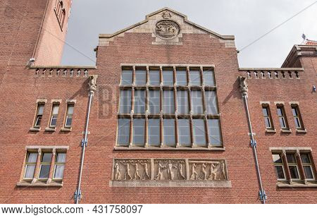 Amsterdam, Netherlands - August 14, 2021: Fresco Details Of Red Brick Stock Exchange Facade With Lar