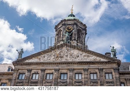 Amsterdam, Netherlands - August 14, 2021: Closeup Of Front Brown Stone Monumental Gable And Clock To