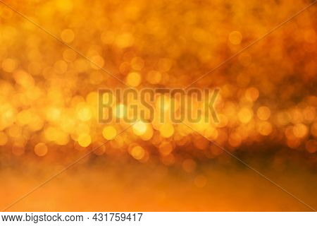 Orange And Yellow Color Abstract Bacground Withe Blurred Defocus Bokeh Light For Template.