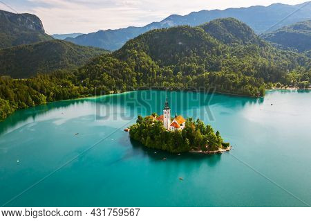 Beautiful Mountain Lake Bled With Turquoise Blue Water With Small Pilgrimage Church On The Island On