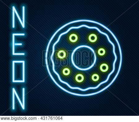 Glowing Neon Line Donut With Sweet Glaze Icon Isolated On Black Background. Colorful Outline Concept