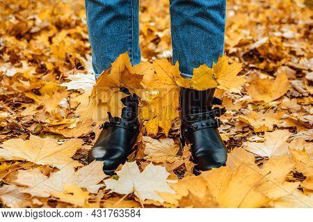 Happy Fall, Hello Autumn. Female Legs In Boots On The Autumn Leaves. Autumn Shoes. Female Legs In Br