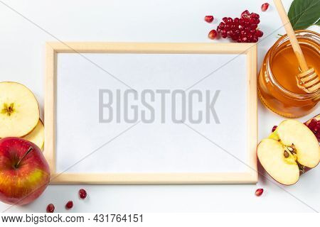 Happy Rosh Hashanah. Frame For Congratulatory Text. Apples, Pomegranates And Honey On A White Backgr