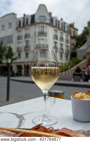 Drinking Of Brut Champagne Sparkling Wine In Street Cafe In Old Central Part Of City Reims, Champagn