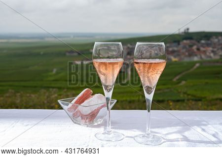Tasting Of Rose Brut Champagne Wine With View On Green Pinot Noir Grand Cru Vineyards Of Famous Cham