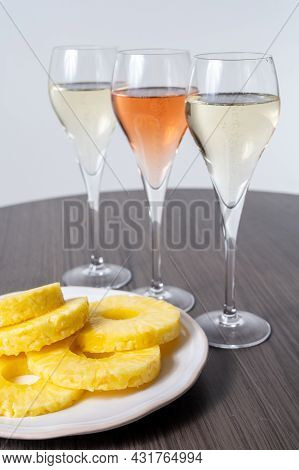 Tasting Of White And Rose Champagne Sparkling Wine From Flute Glasses, Pairing With Fresh Ripe Pinea
