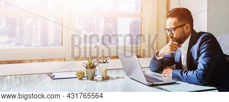 Pondering Thinking Businessman Using Computer. Contemplative Male